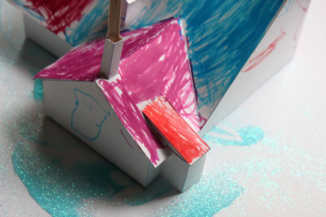 a blue glitter snow paper marker house