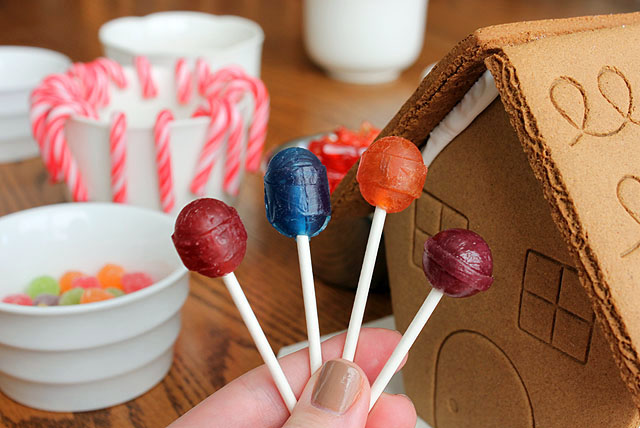 a hand of four candy suckers food groups