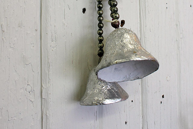 a vintage bead of silver bells