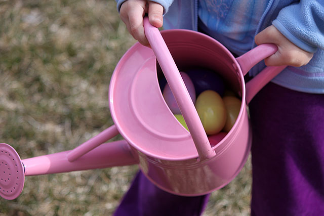 watering pail with plastic eggs