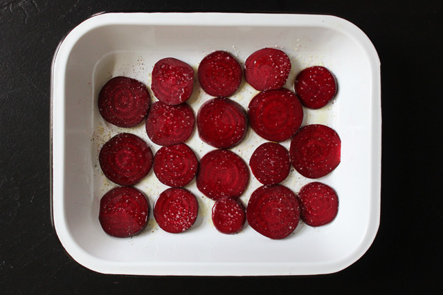 3 sliced beets in pan with salt and pepper