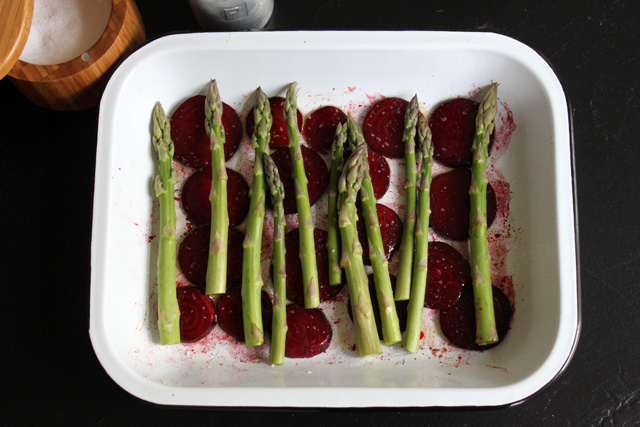 5 asparagus on top of roasted beets salt and pepper