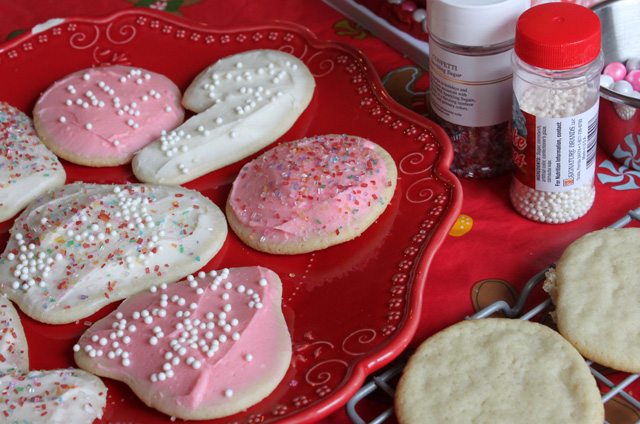 plate of pink and white sugar cookies with sprinkles